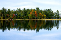 """Reflections of the autumn foilage on a nice, calm, fall day on Hamlin Lake, Ludington Michigan."""