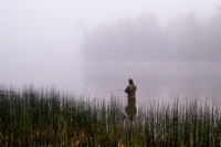 """A lone fly fisherman at dawn on Hamlin Lake, Ludington State Park."""