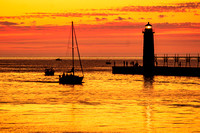 Sailboat at Sunset in Manistee Michigans Harbor